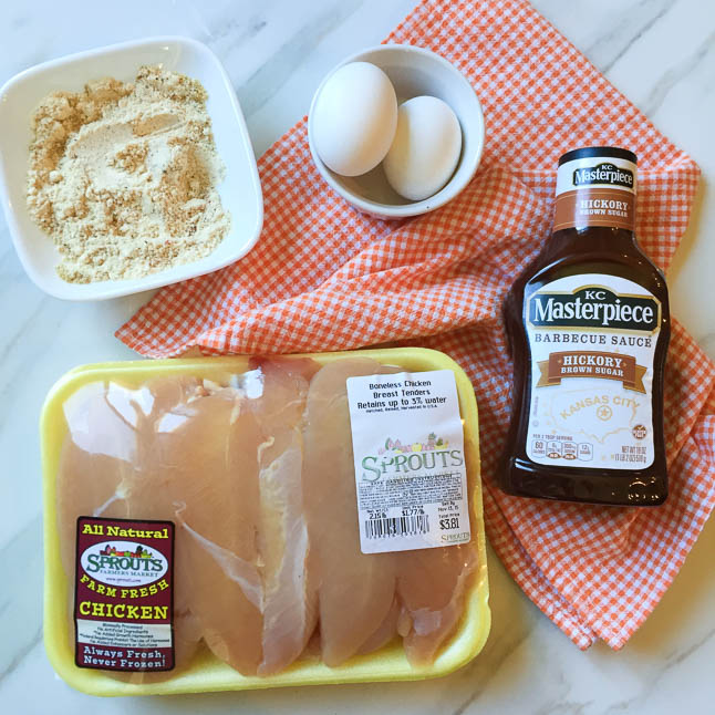 Healthy Baked Chicken Fingers with BBQ Dipping Sauce- a healthy, gluten-free version of the fried chicken fingers we love!   adoubledose.com