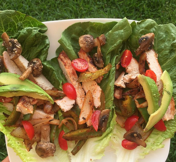 Juicy, Chicken Fajitas-The juicy strips of chicken sizzling on the cast iron skillet mixed with the marinated peppers and onions have our mouths watering each time we think of them! Not only were they super easy to prepare, but we had TONS of leftovers for the rest of the week to put on top of salads, or mix into other dishes! | Double Dose Fitness