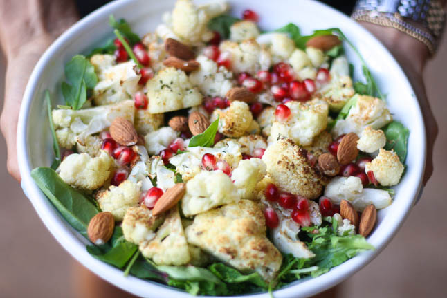 Turmeric Roasted Cauliflower with Pomegranate Seeds, Almonds, and Arugula - The best tasting cauliflower with an autumn flair | adoubledose.com