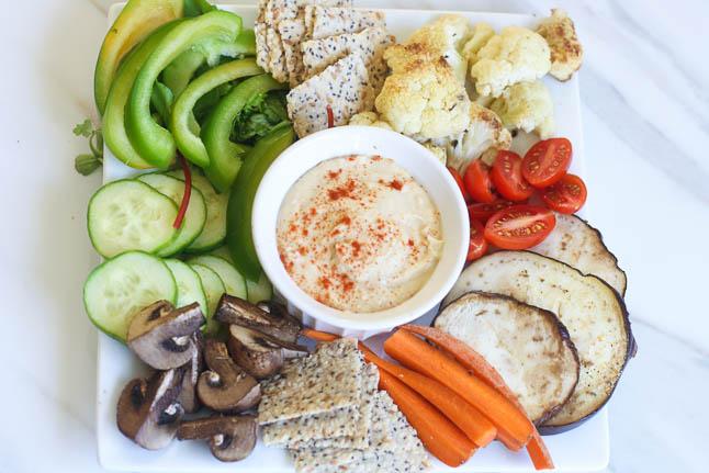 Mediterranean Mezza Plate- veggie crudites, homemade hummus, and crisp Paleo crackers  adoubledose.com