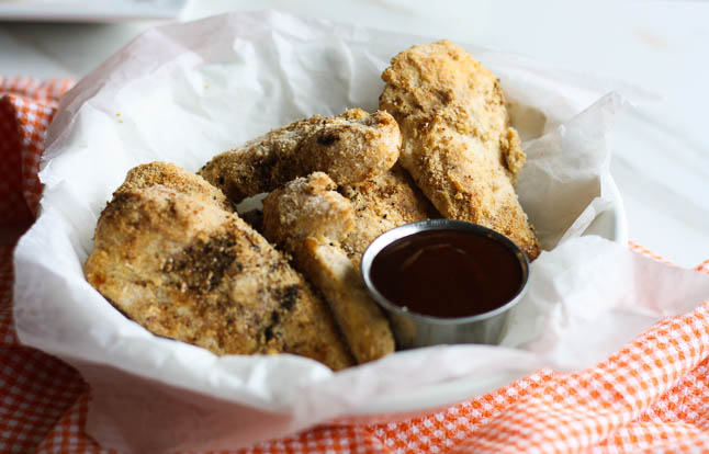 Healthy Baked Chicken Fingers with BBQ Dipping Sauce- a healthy, gluten-free version of the fried chicken fingers we love! | adoubledose.com