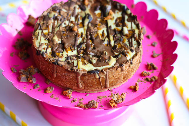 Better-For-You Butterfinger Cheesecake - a personal-sized cheesecake loaded with peanut butter, chocolate, and chunks of butterfinger | adoubledose.com
