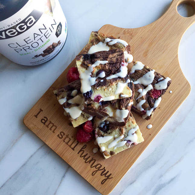 Chocolate Raspberry Cheesecake Bars - a protein-packed chocolate cheesecake treat filled with raspberries and blueberries | adoubledose.com
