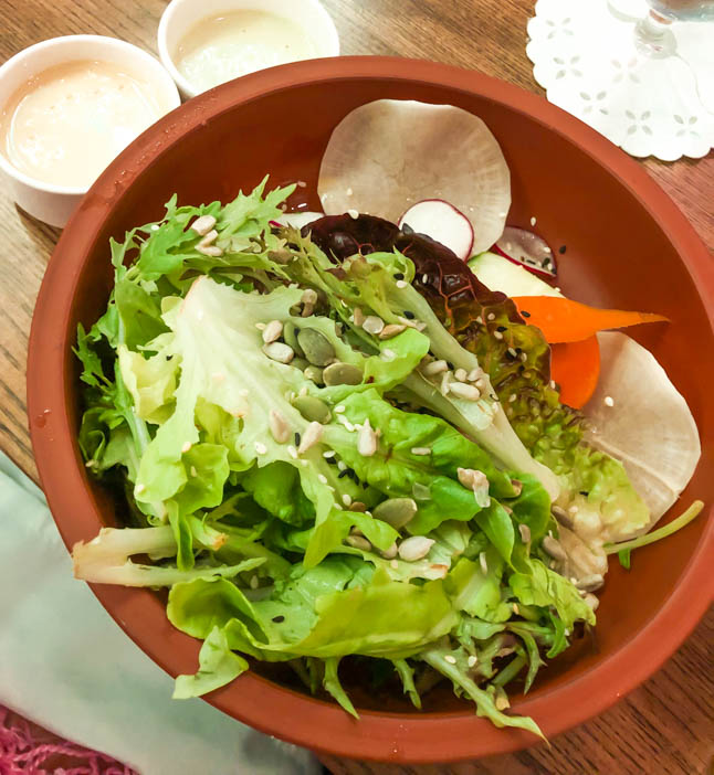 green salad at Agua restaurant in grand cayman island with tahini dressing