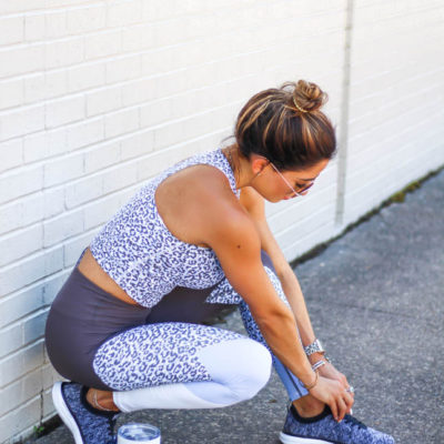 fashion and fitness blogger wearing a leopard cropped tank and leopard and grey color block leggings from betsey johnson for an athleisure look