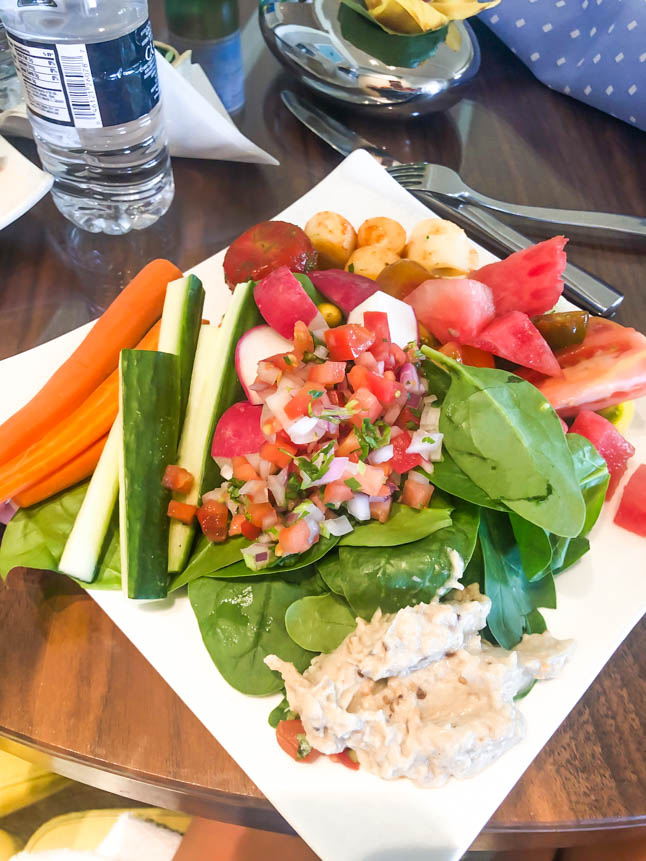 spinach, carrots, cucumbers and fresh vegetables with hummus at the club at the ritz carlton grand cayman