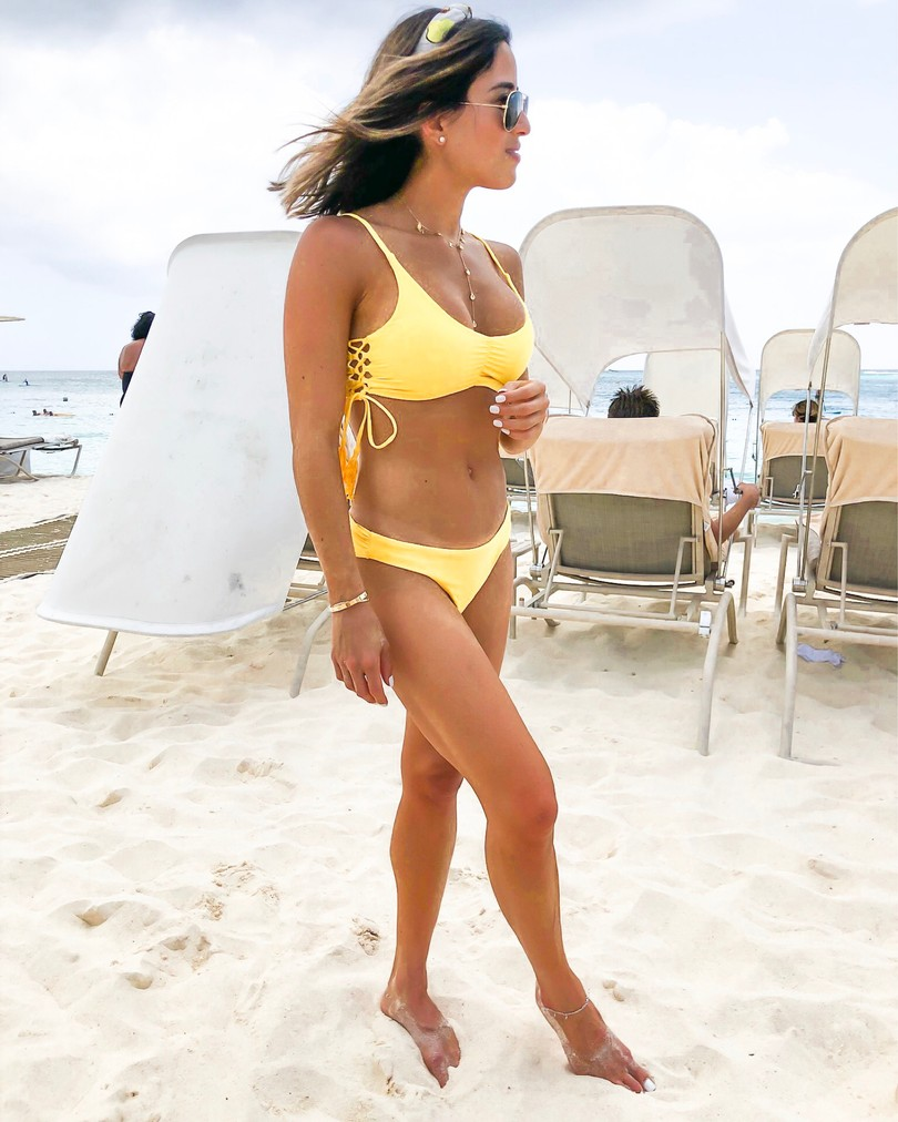 fashion blogger wearing a yellow pilyq bikini