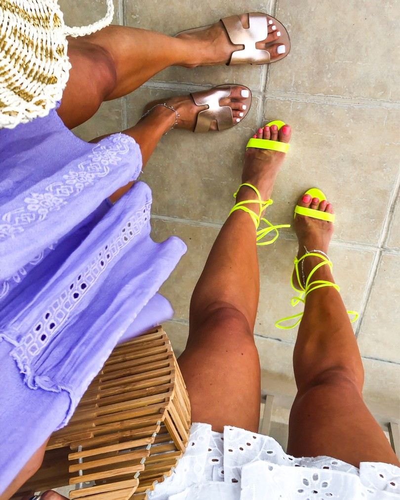 fashion bloggers wearing steve madden rose gold slide sandals and neon green lace up sandals