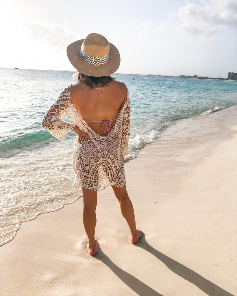fashion blogger wearing crochet cover up from amazon on seven mile beach