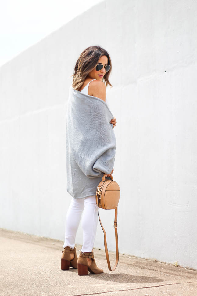lifestyle and fashion blogger Alexis Belbel of A Double Dose wearing white jeans for petites, a white silk cami, grey shawl/cardigan, suede peep toe booties and a tan crossbody round bag from sole society
