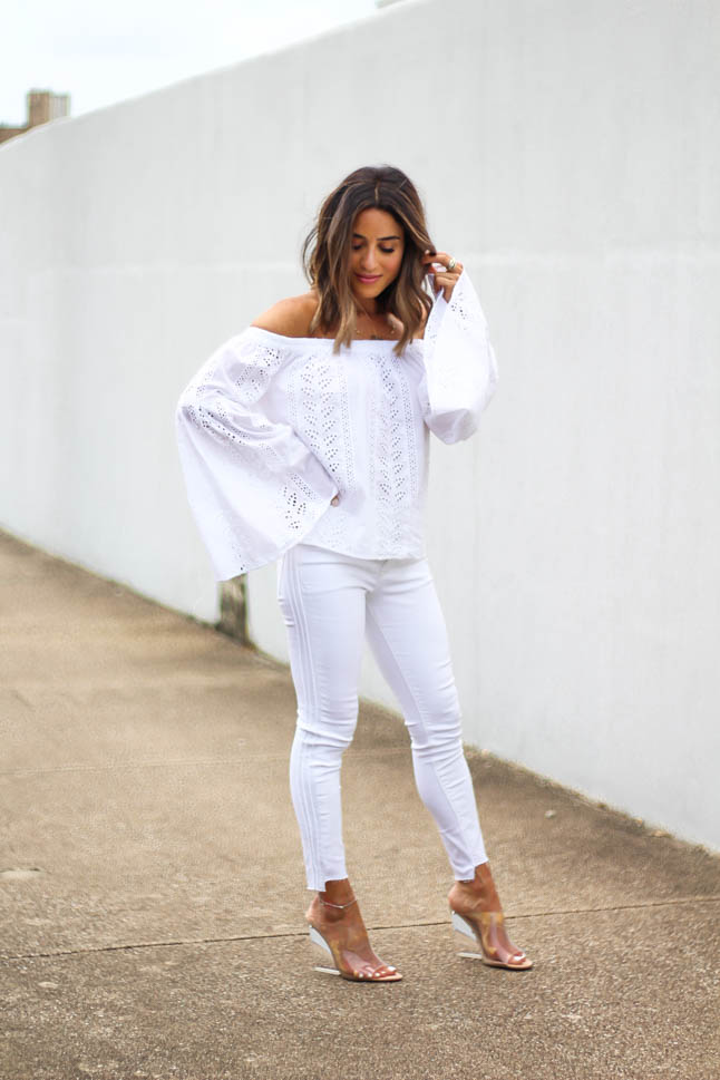 lifestyle and fashion blogger alexis belbel shares an all white look from express: a white off shoulder eyelet top with bell sleeves and some skinny white ankle jeans with clear wedge sandals