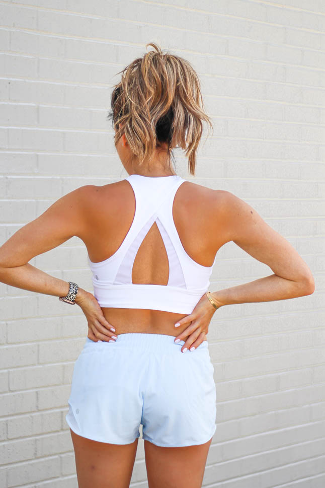 lifestyle and fashion bloggers samantha and alexis belbel of A Double Dose wearing lululemon summer pieces - blue running shorts and white strappy sports bra and camo align shorts and white bra