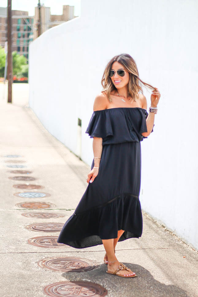 fashion and lifestyle blogger alexis belbel of a double dose wearing an off shoulder black maxi dress with tory burch miller sandals