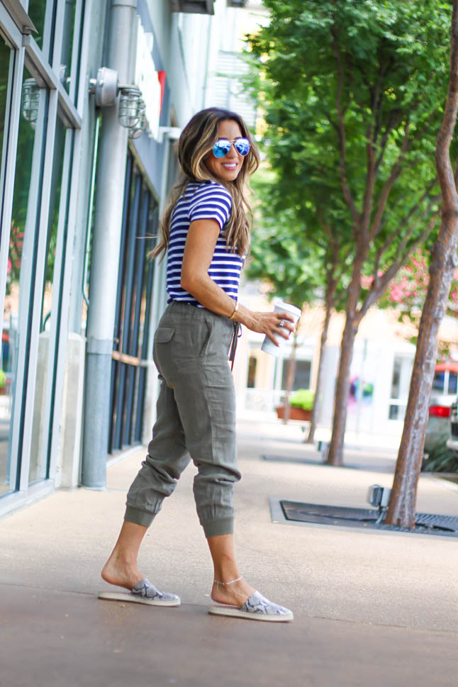 fashion and lifestyle blogger samantha belbel of adoubledose.com wearing olive green linen joggers with a striped short sleeved tee and snakeskin mules from Nordstrom