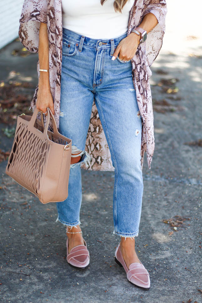 fashion and lifestyle blogger samantha belbel wearing a python print kimono with an ivory bodysuit and distressed girlfriend jeans with pointed blush velvet loafers from sole society