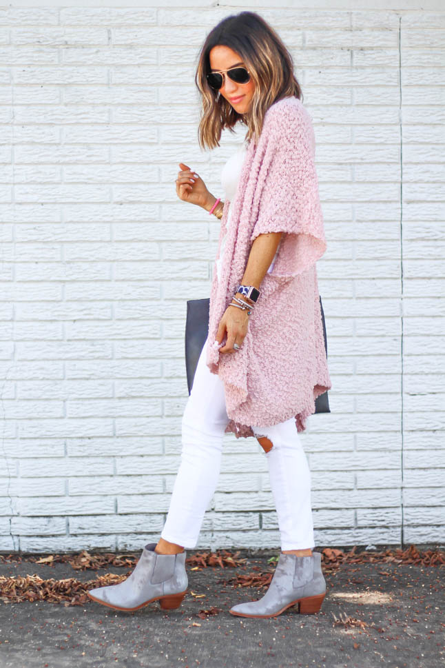 fashion and lifestyle blogger alexis belbel of a double dose wearing white ripped jeans for petites from abercrombie, a white lace cami from express, a pink wrap sweater from sole society and a grey tote bad and grey booties from sole society.