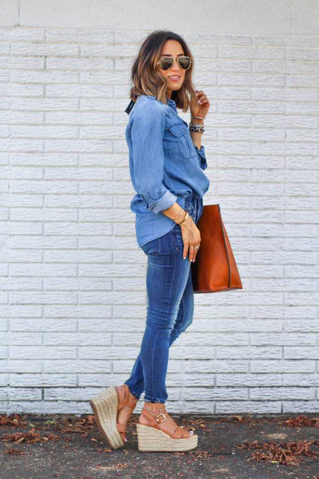 fashion blogger alexis belbel of a double dose wearing a denim button down shirt and skinny dark jeans for petites from express with a tan tote bag from sole society and some sam edelman neutral espadrille wedges