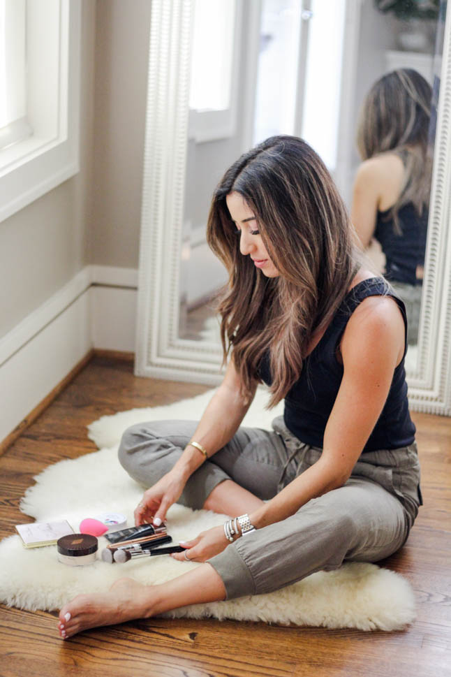 fashion and lifestyle blogger samantha belbel of a double dose wearing some olive linen joggers and a black tank sharing her must haves for a flawless face using Charlotte Tilbury concealer and genius magic powder from Nordstrom