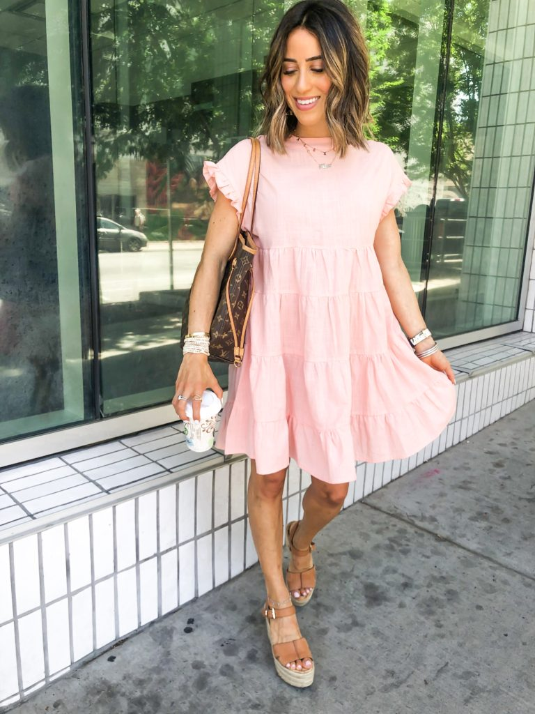 fashion and lifestyle blogger alexis belbel wearing  a pink tiered dress from shein with sam edelman espadrille wedges