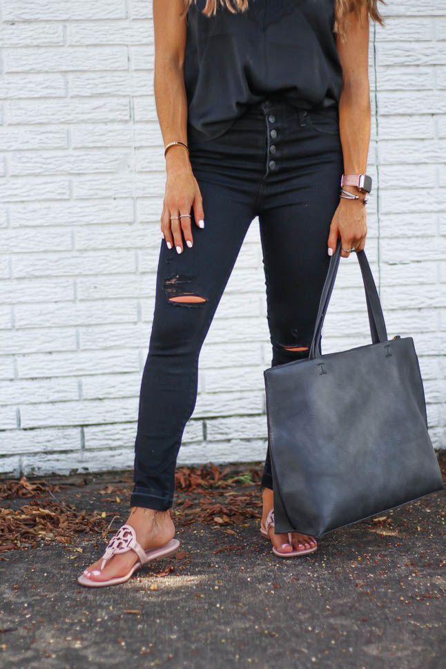 lifestyle and fashion blogger samantha belbel wearing a black lace cami from abercrombie with black ripped skinny jeans and tory burch miller sandals