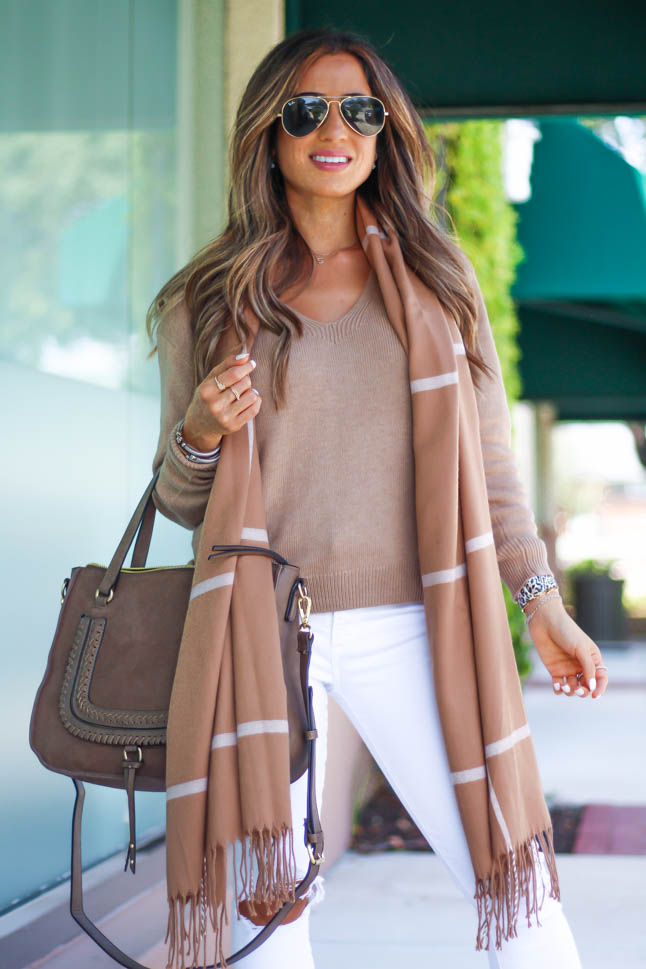 lifestyle and fashion blogger samantha belbel of a double dose wearing a tan neutral sweater from express with white jeans with rips, a neutral windowpane fringe scarf, a suede satchel bag from sole society, and snakeskin python pointed flats for a fall outfit