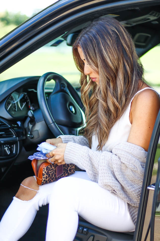 lifestyle and fashion blogger samantha belbel wearing white ripped jeans and a taupe cozy cable knit cardigan from express sharing a review of organic Lola tampons and liners