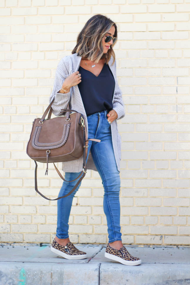 lifestyle and fashion blogger alexis belbel wearing a head to toe look from express. Cable knit taupe cardigan, black silk cami, high rise stretchy skinny jeans and leopard slip on sneakers