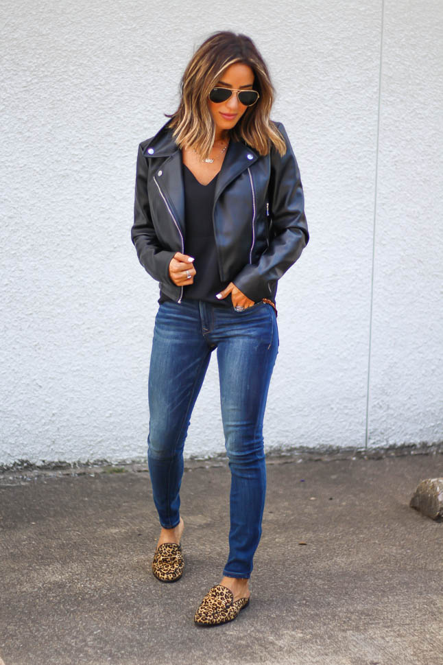 lifestyle and fashion blogger, alexis belbel, of A Double Dose, wearing stretchy jeans for petites from express with a faux leather moto jacket from Express and some sam edelman leopard loafer mules from shoes.com
