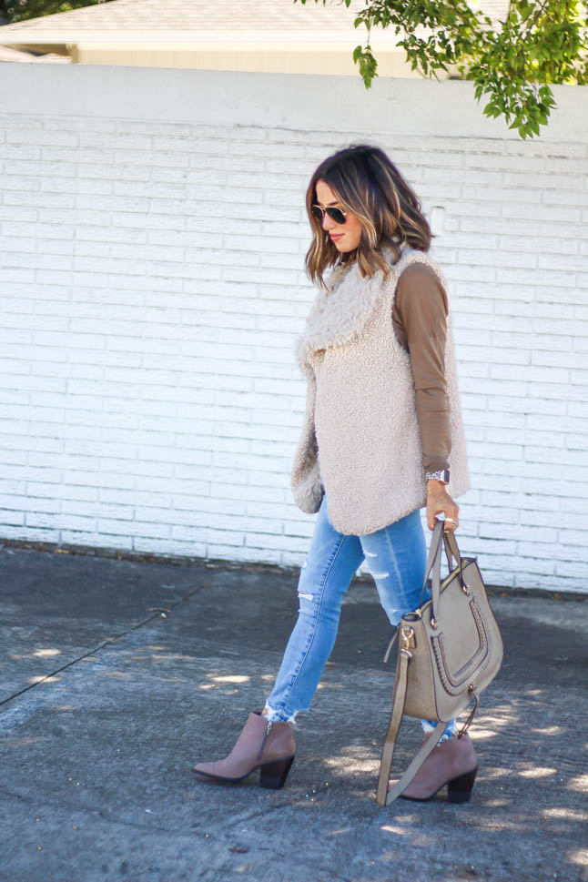 lifestyle and fashion blogger alexis belbel wearing a neutral sherpa vest from sole society with a tan long sleeve shirt and ripped jeans from abercrombie with a taupe satchel bag and pointed booties from sole society | adoubledose.com
