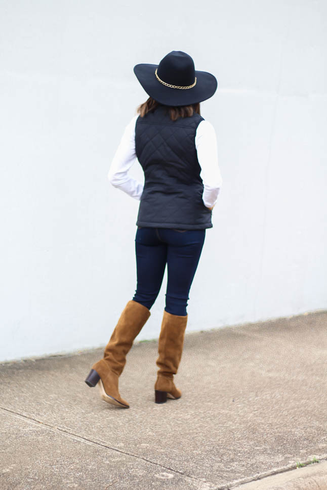 lifestyle and fashion blogger, alexis belbel, of a double dose wearing a head-to-toe look from walmart. Black quilted vest, white long sleeve tee, dark skinny legging jeans, suede boots, and black wool hat