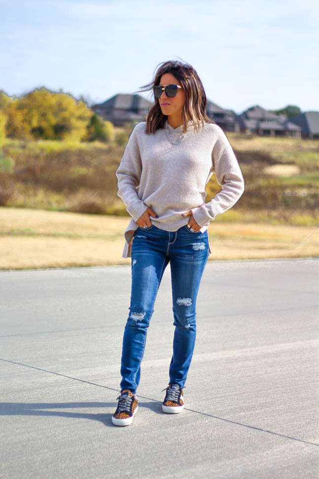 lifestyle and fashion blogger alexis belbel wearing a waffle pullover sweater and ripped jeans from Walmart Fashion - We Dress America with leopard steve madden sneakers  | adoubledose.com