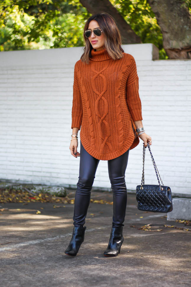 lifestyle and fashion blogger alexis belbel wearing a cable knit tunic sweater with black faux leather leggings from express for thanksgiving outfit ideas  | adoubledose.com