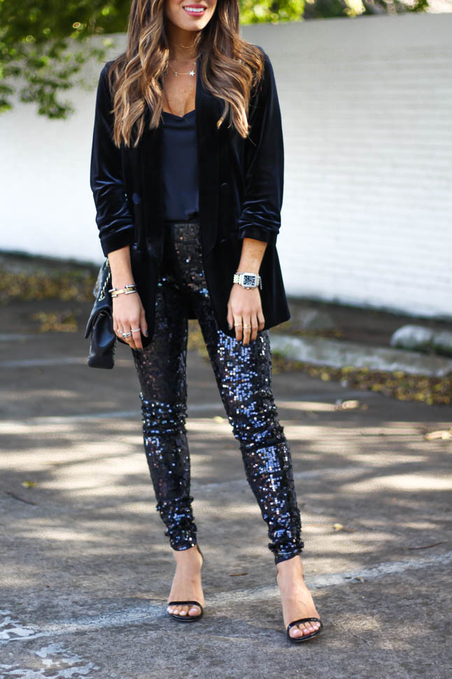 lifestyle and fashion blogger wearing a head to toe look for the holidays from express: black sequin leggings, black velvet blazer, black cami, black sandal from sam edelman | adoubledose.com