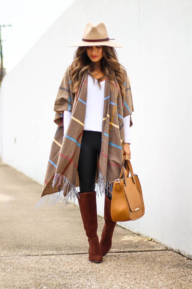 lifestyle and fashion blogger samantha belbel wearing plaid windowpane poncho cape from sole society with a tan hat, black faux leather spanx leggings, tan satchel bag and suede boots from sole society | adoubledose.com