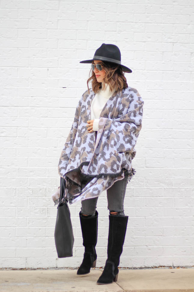 lifestyle and fashion blogger alexis belbel wearing a leopard poncho cape with an ivory free people sweater tunic, black hat and black suede boots from sole society  | adoubledose.com