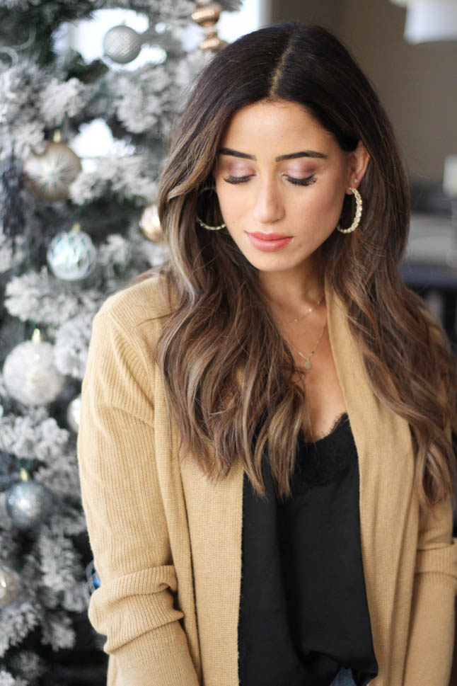 lifestyle and fashion blogger samantha belbel wearing kendra scott hoop earrings, kendra scott layered necklace, kendra scott cocktail ring and cuff bracelet for the holidays with a camel colored cardigan and black lace cami  | adoubledose.com