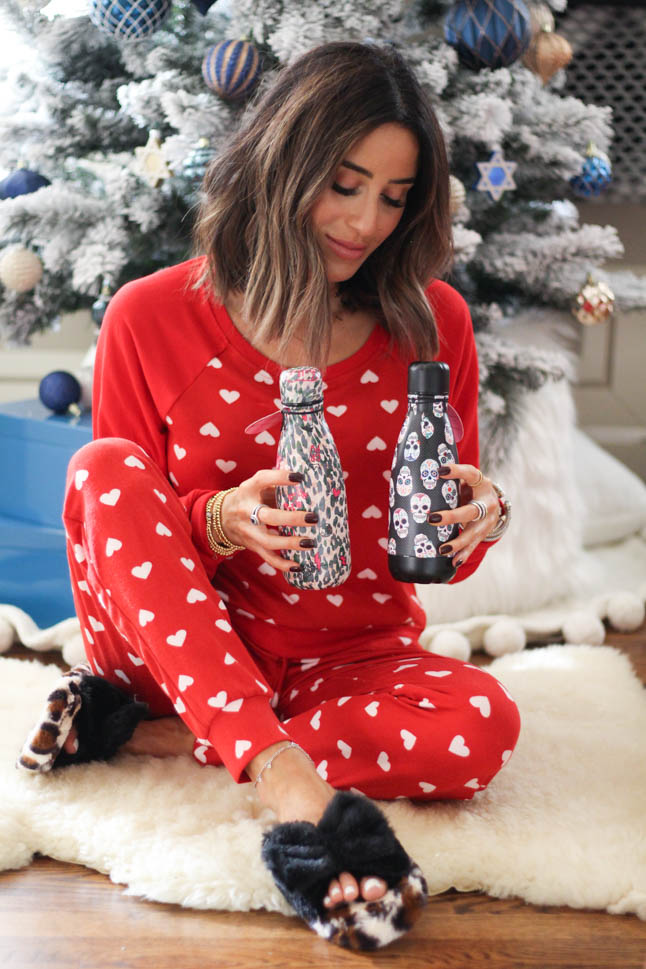 lifestyle and fashion blogger alexis belbel sharing gifts for your best friend, sister, cousin, aunt, for her Betsey Johnson. Wearing red heart pajama set and leopard fuzzy slippers | adoubledose.com
