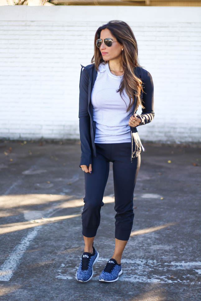 lifestyle and fashion blogger samantha belbel wearing black lululemon align joggers with lululemon short sleeve swiftly crew neck top and apl sneakers  | adoubledose.com