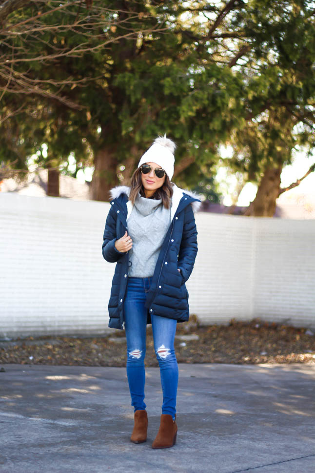 lifestyle and fashion blogger alexis belbel wearing sherpa parka jacket from hollister in black, grey cable turtleneck sweater from hollister, ripped legging jeans from hollister co, brown suede booties from vince camuto, white pom pom cable beanie from hollister | adoubledose.com