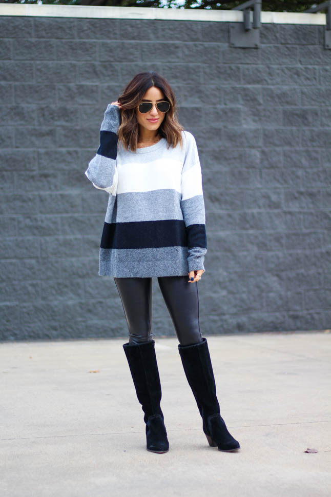 lifestyle and fashion blogger alexis belbel wearing grey, black, and white colorblock sweater from Walmart with faux leather leggings and black suede boots | | adoubledose.com