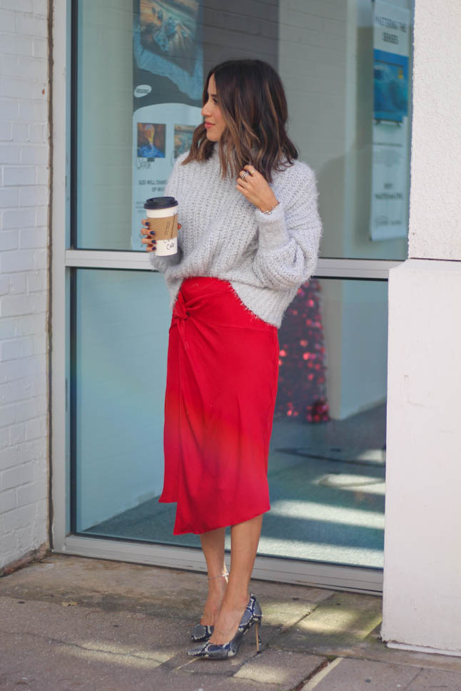 lifestyle and fashion blogger alexis belbel wearing a red satin skirt and fuzzy sweater from express with snakeskin pointed pumps | adoubledose.com
