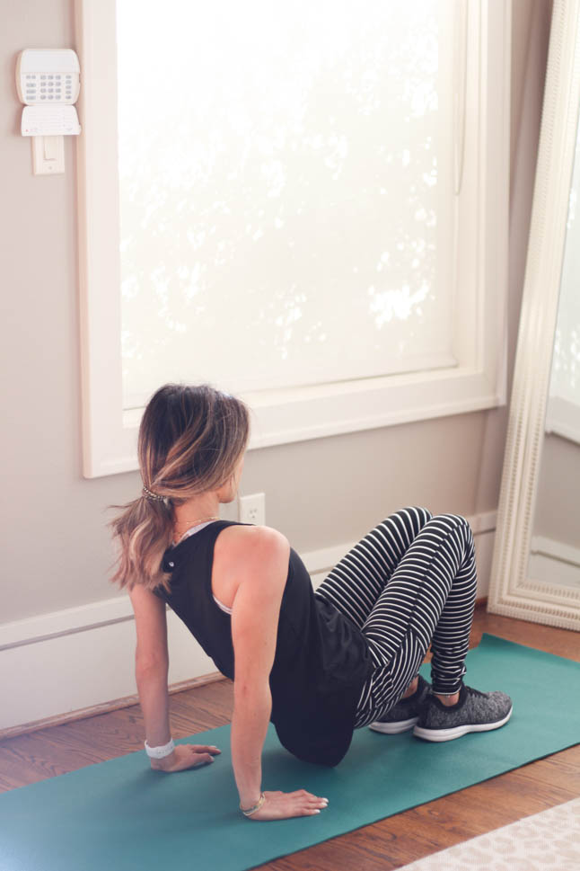 lifestyle and fashion blogger alexis belbel wearing a stripe legging and black workout tank and apl sneakers from Walmart sharing 5 easy at home exercises for a workout in january  | adoubledose.com