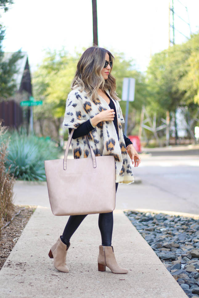 lifestyle and fashion blogger alexis belbel wearing a leopard cardigan sweater from sole society with suede booties from sole society with spanx faux leather leggings and a taupe tote bag from sole society| adoubledose.com