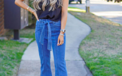 lifestyle and fashion blogger samantha belbel wearing flare jeans and a black lace cami with wedges from Express sharing what is in vs out in fashion spring 2020 trends | adoubledose.com