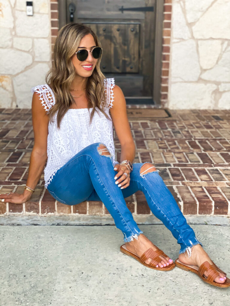 lifestyle and fashion blogger alexis belbel sharing how to style green shorts with a denim jacket and lace bodysuit from express and a white lace top with ripped skinny jeans for petites | adoubledose.com