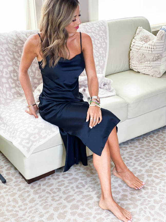lifestyle and fashion blogger samantha belbel sharing how to style a black slip dress for work, date night, or time with friends from express | adoubledose.com