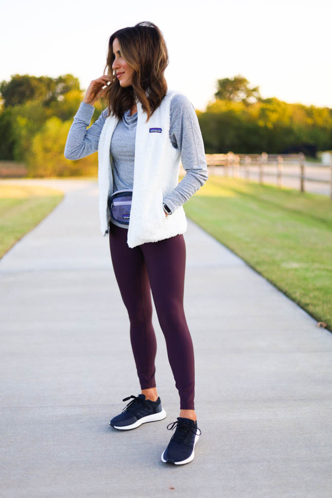 lifestyle and fashion blogger alexis belbel sharing a fall walking outfit from backcountry wearing a patagonia los gatos vest with alo airlift leggings and sharing benefit of walking outdoors | adoubledose.com
