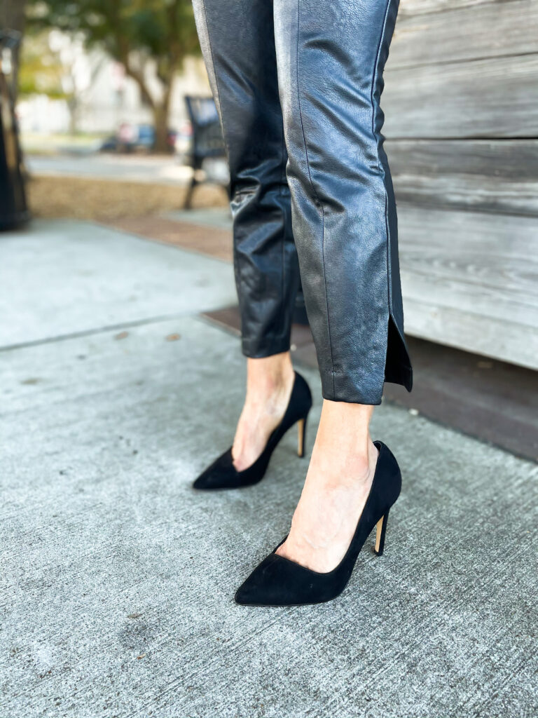10 Things We Have Learned in 2020 wearing faux leather pants from expess with a cowl neck sweater and black pumps nye outfit idea | adoubledose.com