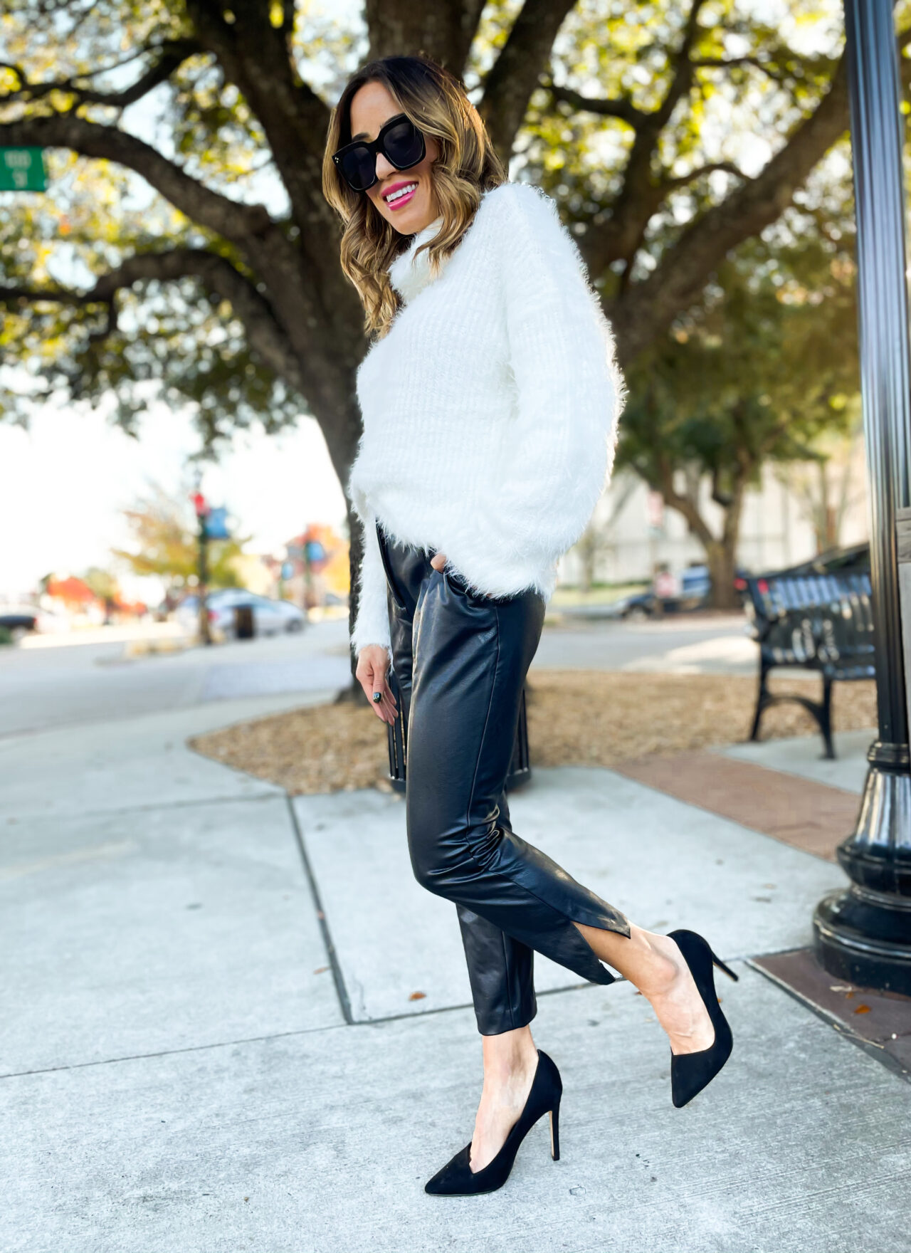 10 Things We Have Learned in 2020 wearing faux leather pants from expess with a cowl neck sweater and black pumps nye outfit idea   adoubledose.com