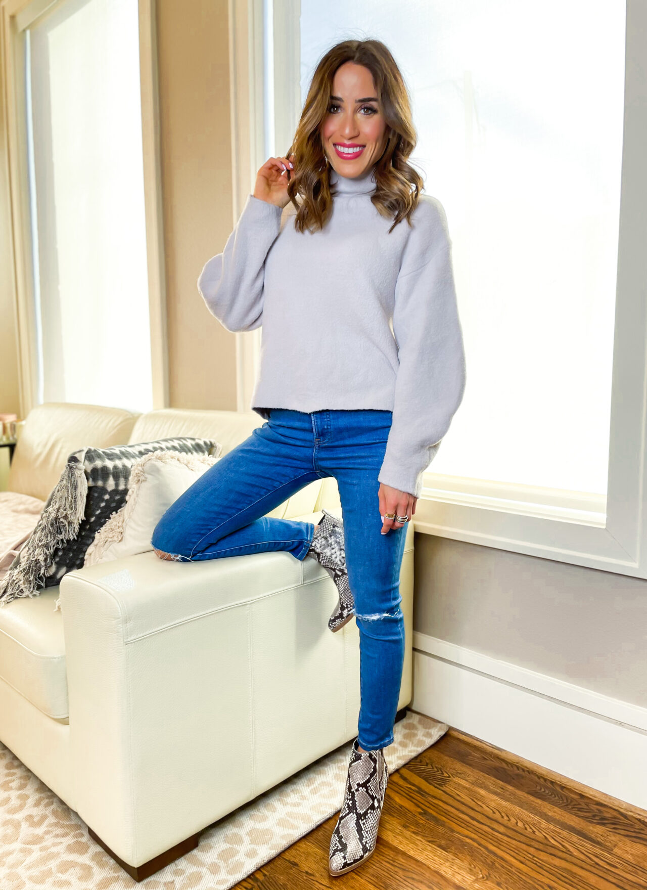 lifestyle and fashion blogger alexis belbel sharing her favorite petite jeans from express and some cozy sweaters and bodysuits you can pair with them   adoubledose.com